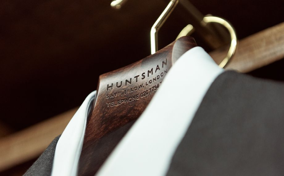 Huntsman Bespoke Process - Garment on Wooden Huntsman Branded Hanger