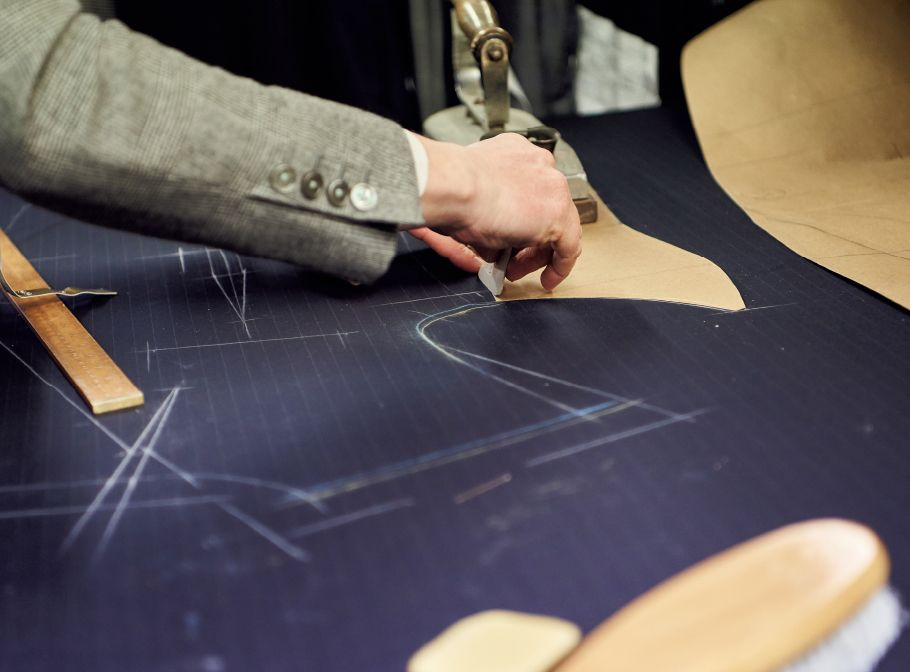 Huntsman Bespoke Process - Tailor drawing suit pattern on bespoke cloth