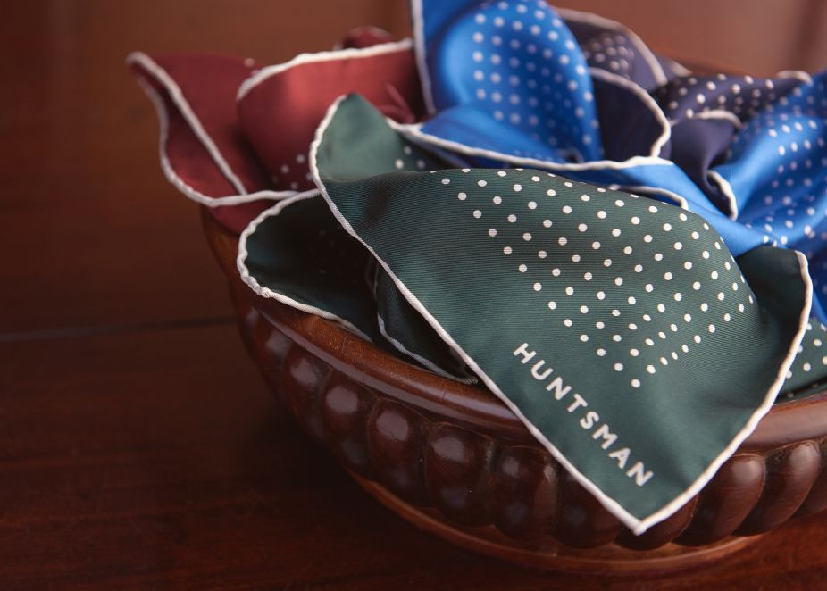 Sourcing the Best - Selection of printed silk pocket squares in a bowl