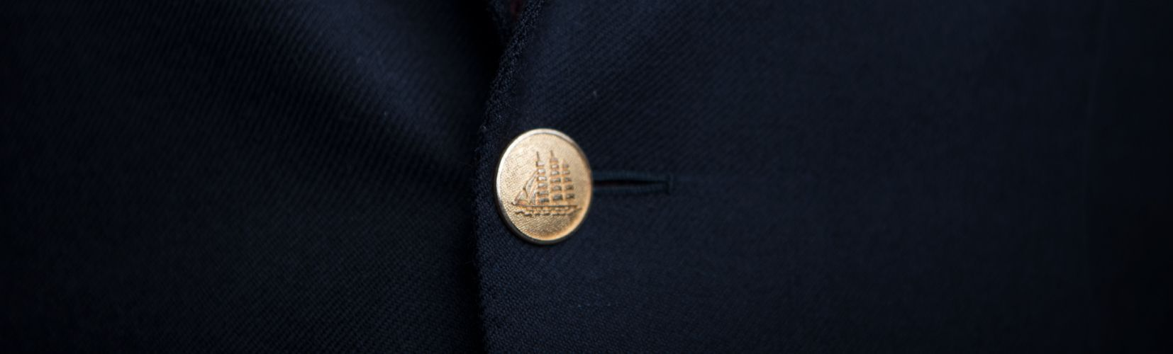 Huntsman Tailoring Shop Heading Image - Gold Button on One Button Suit